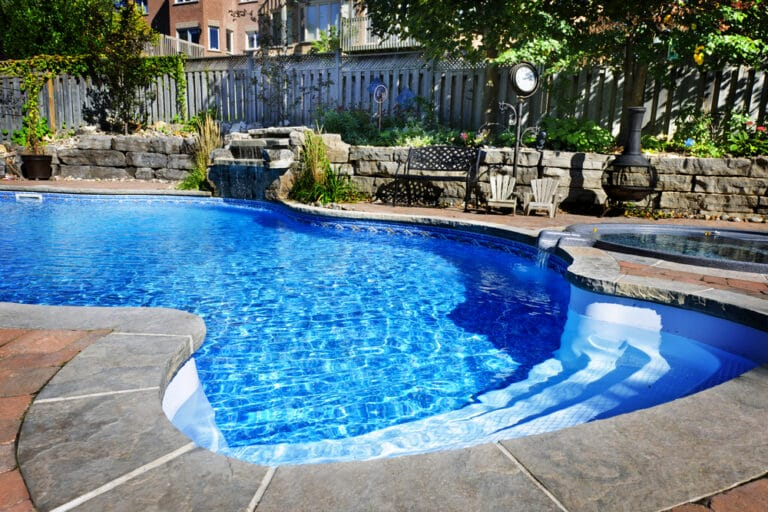 Home pool with waterfall feature