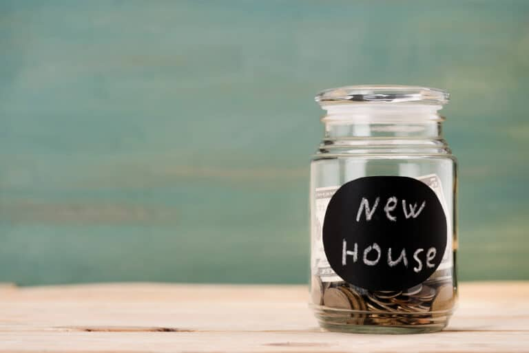 """Coins in glass jar with label """"new house"""""""